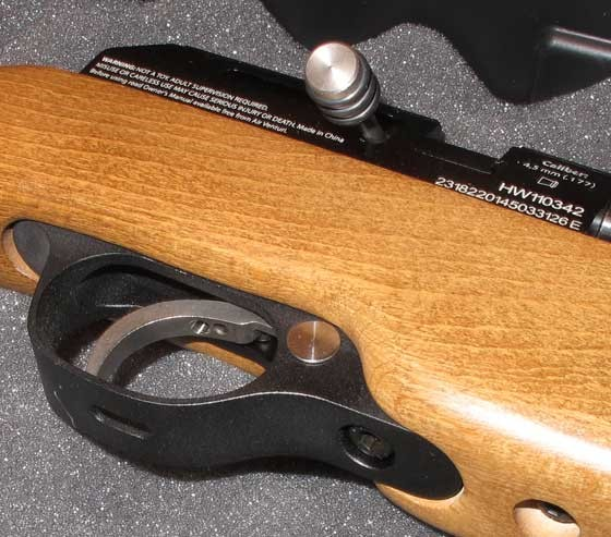 Gen 2 trigger with hole in the trigger guard for adjustment of screws.