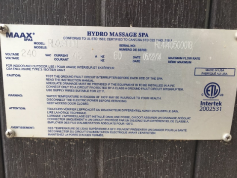 Serial number plate on front corner of hot tub
